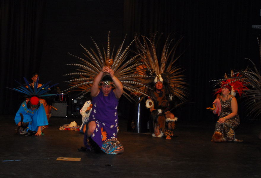 Dancers in costume on stage